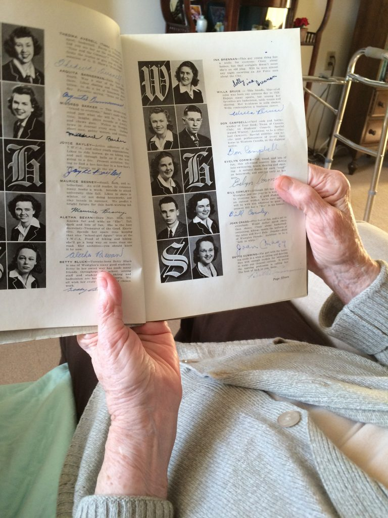 Mom reading her 1940 yearbook entry
